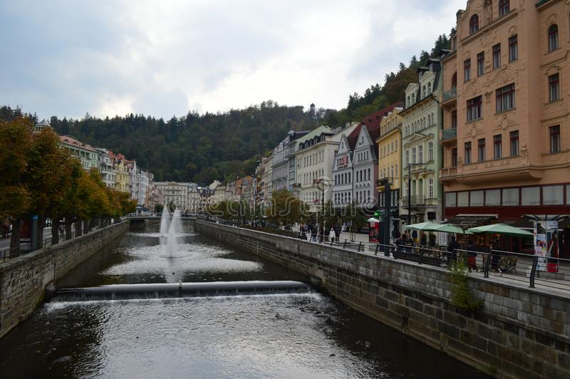 River Tepla and typical colourful terrace buildings in Karlovy Vary Czech Republic. River Tepla and typical colourful terrace building in Karlovy Vary Czech stock images