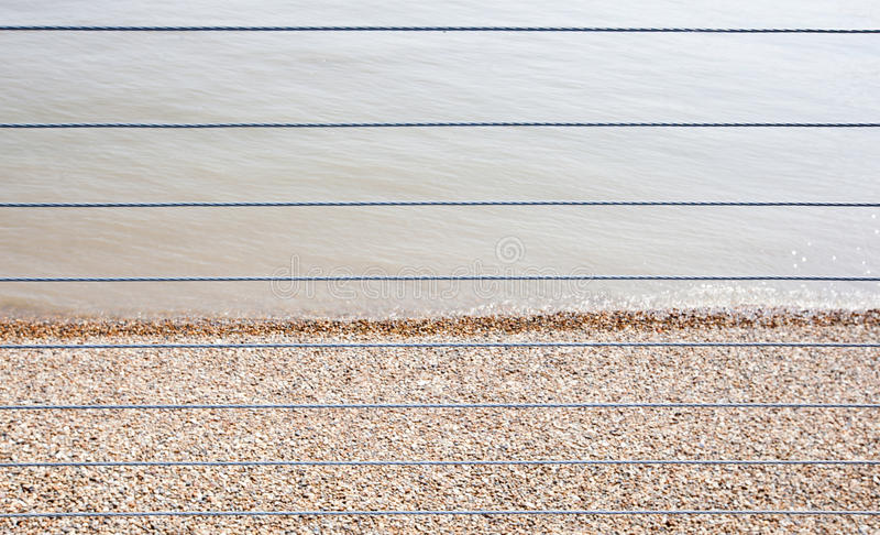 River Thames And Shingle Beach Behind Wire Rope Fence Stock Photo ...