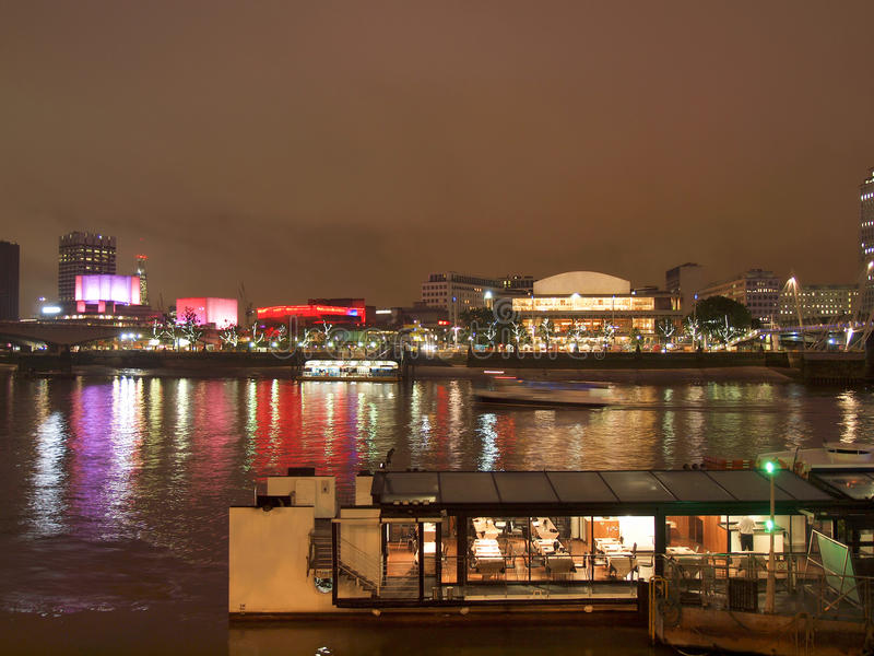 River Thames South Bank, London. River Thames South Bank in London UK - at night stock photography