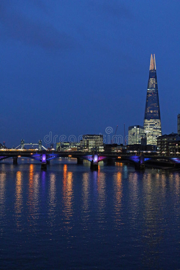 River Thames, Tower Bridge and The Shard, London at night. Looking down the River Thames from the London Millennium Footbridge towards the Shard and, in the stock photography