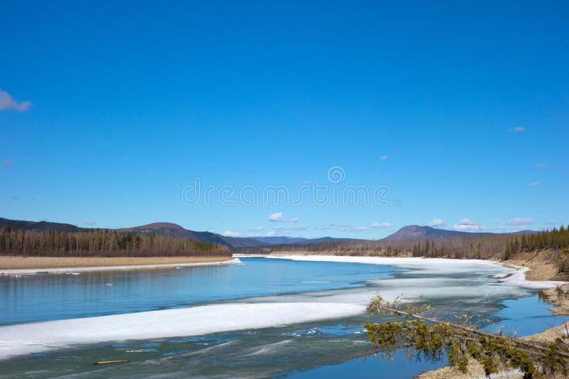 A river thawing in northern british columbia. The mighty liard breaking up in the springtime royalty free stock photo