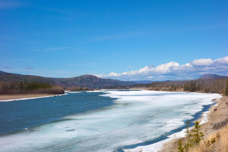 A river thawing in northern british columbia royalty free stock image