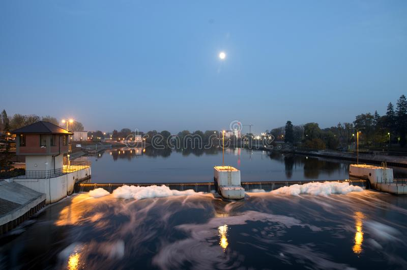 River treshold in Opole city on the Odra. River treshold on the Odra at night in Opole city royalty free stock photography