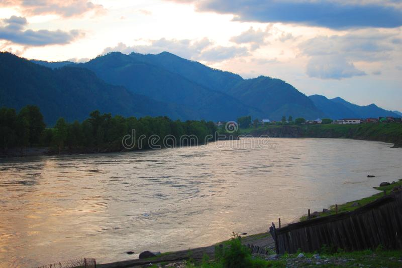 River under a mountain on a sunset stock images