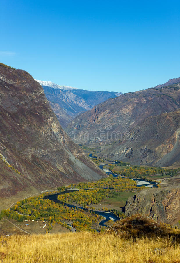 River in a valley stock image