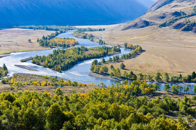 River in a valley stock photography