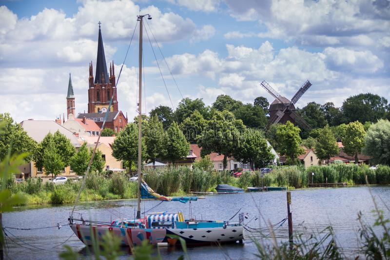 River view with boat and church in background stock photos