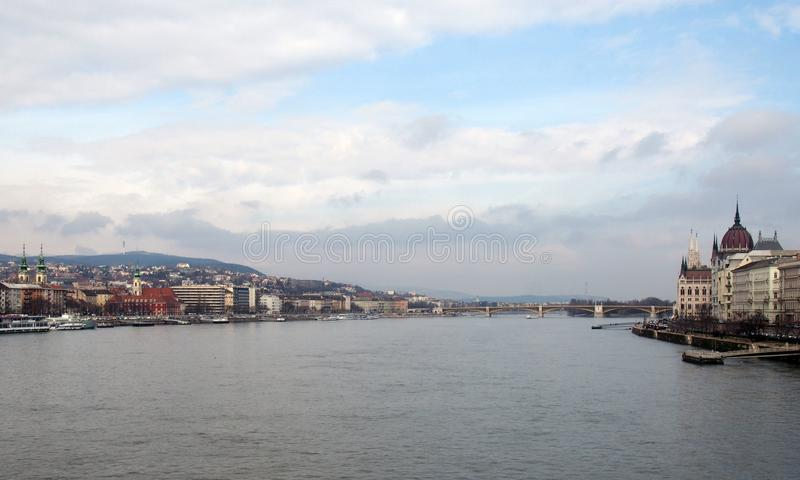 River view of budapest with historic buildings on both sides of the danube with Margaret bridge and island in the distance royalty free stock photos