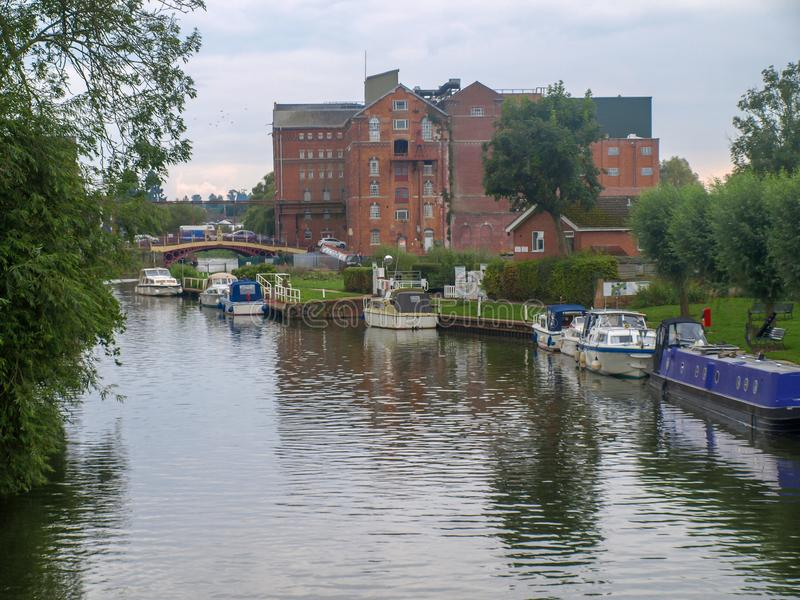 River view in Tewkesbury. River view of the river avon with mooring boats in Tewkesbury in Gloucestershire, Great Britain stock images