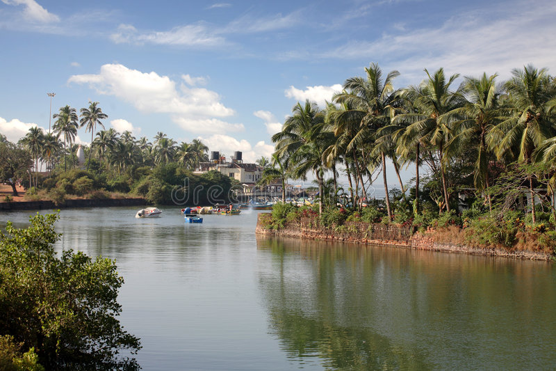 Download River With Village On Banks Stock Image - Image: 3868675