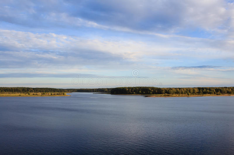 River Volga valley with fields and forest under cloudy sky royalty free stock photography