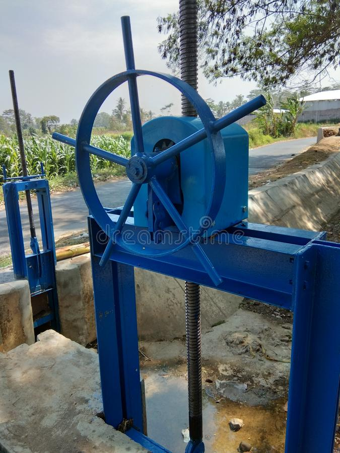 River water flow regulators in irrigation dams stock images