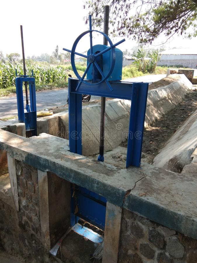 River water flow regulators in irrigation dams royalty free stock photos