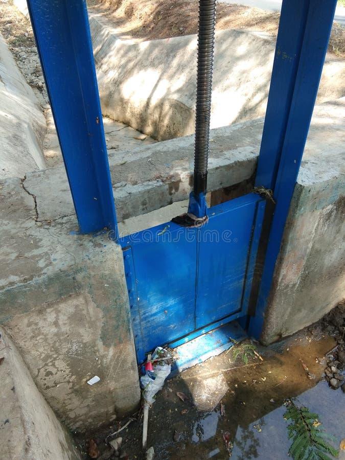 River water flow regulators in irrigation dams stock photography