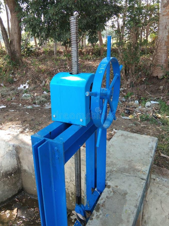 River water flow regulators in irrigation dams stock photo