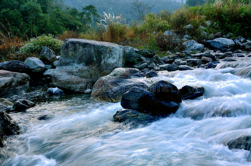 River water flowing through rocks at dawn royalty free stock photography