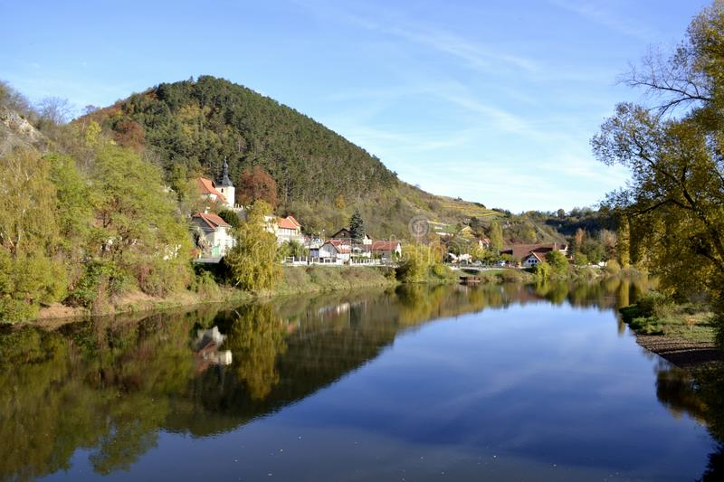 River with water reflections. And houses stock images