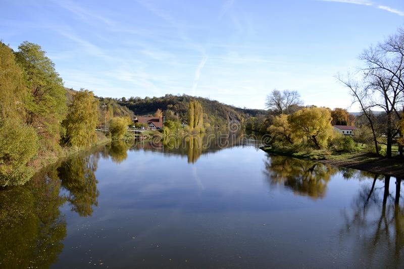 River with water reflections. And houses stock photography