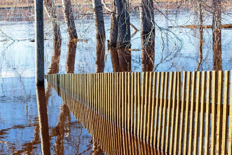 Water spring came out of the shore and flooded the fence royalty free stock photos