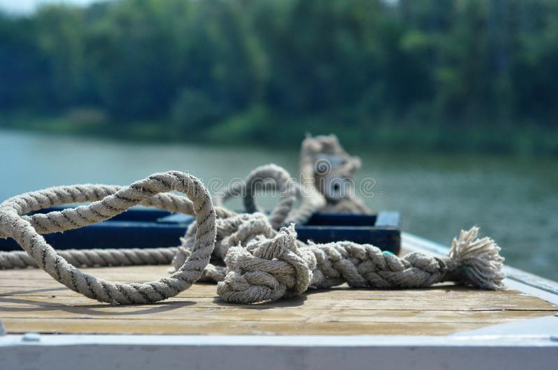 River water transport. Long mooring rope on a yacht stock photos