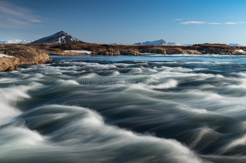 Icelandic river waves with a mountain background royalty free stock photo
