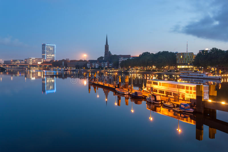 River Weser, Bremen, Germany. Reflection of Bremen skyline in the calm waters of river Weser, in Bremen Germany royalty free stock image