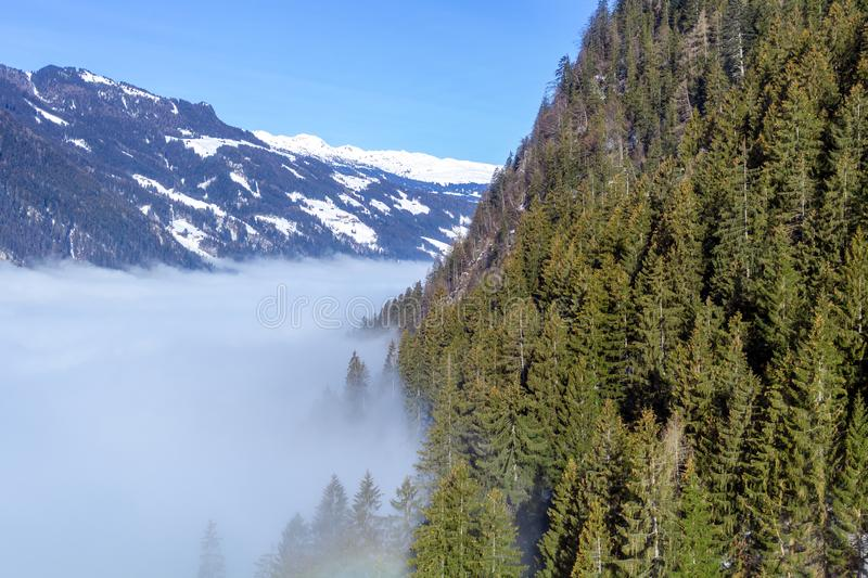 The river of white fog in mountains.Alpine Alps mountain landscape at Tirol, Top of Europe royalty free stock images