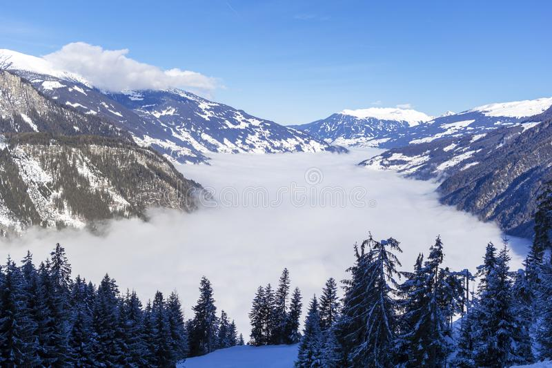 The river of white fog in mountains.Alpine Alps mountain landscape at Tirol, Top of Europe. The river of white fog in mountains.Austrian Alps in winter.Alpine royalty free stock photo