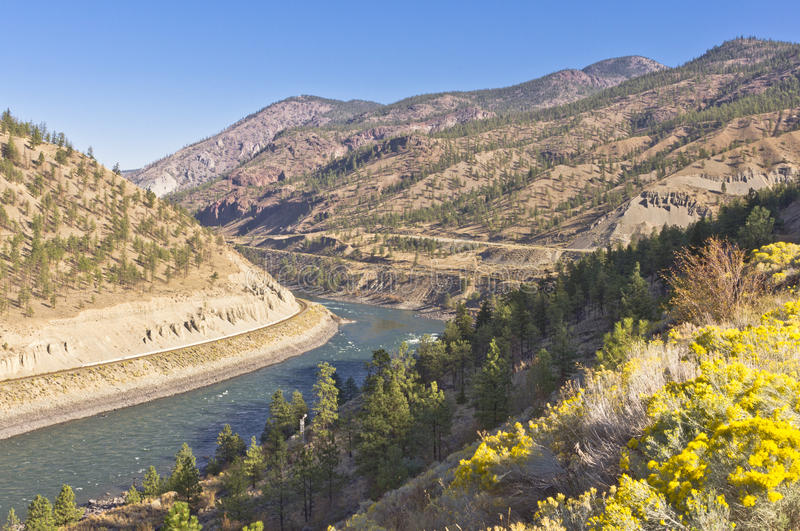 River winding through dry mountains. The Thompson river with rapids winding through the dry mountains in the interior of BC, Canada near Spences Bridge royalty free stock photography