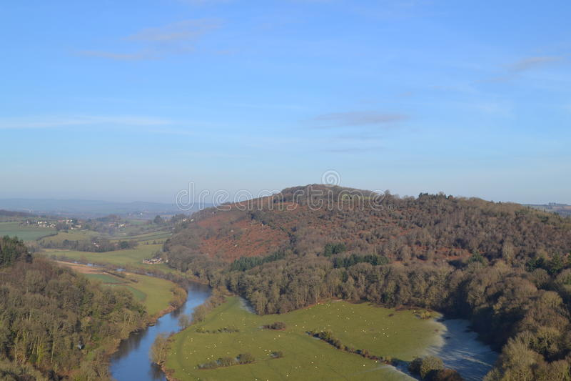A river winding through a valley stock image