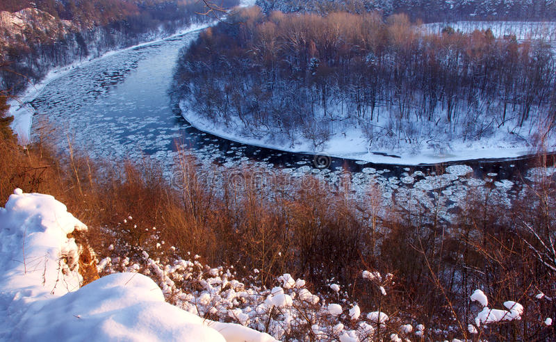 River wing in winter time with snow and ice royalty free stock image