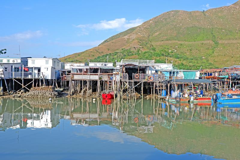 River, wooden house, village with reflection in Hong Kong countryside stock photography