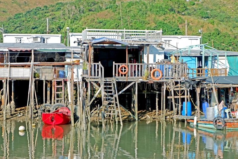 River, wooden house, village with reflection in Hong Kong countryside stock image