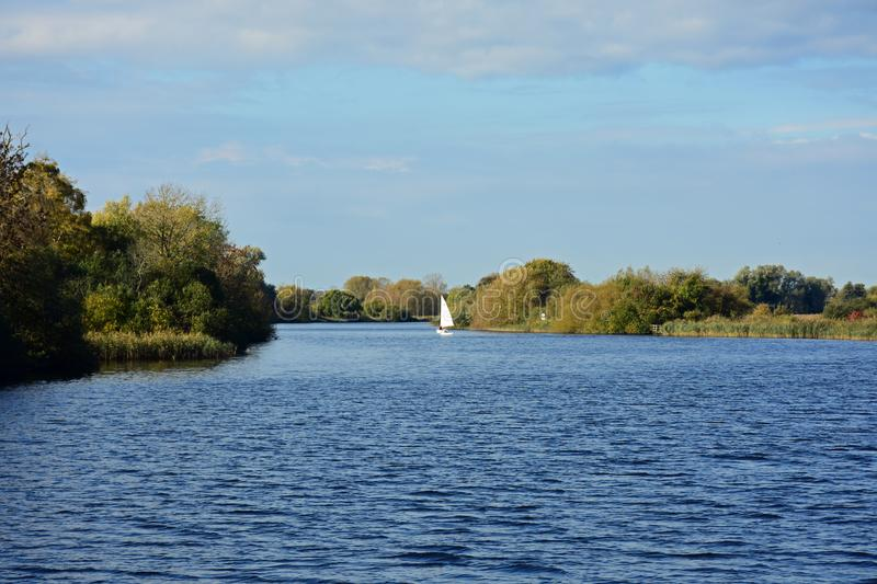 River Yare, Strumpshaw Fen, Norfolk, England. Sailing boat on River Yare, RSPB Nature Reserve at Strumpshaw Fen, Norfolk Broads near Norwich, Norfolk, England stock photos