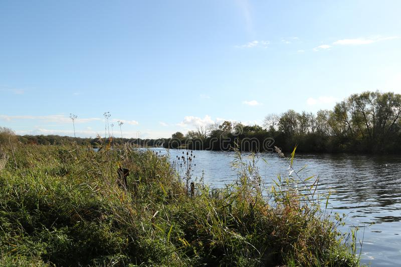 The River Yare at Strumpshaw Fen. Strumpshaw Fen is a RSPB bird reserve on the River Yare near Norwich, Norfolk stock image