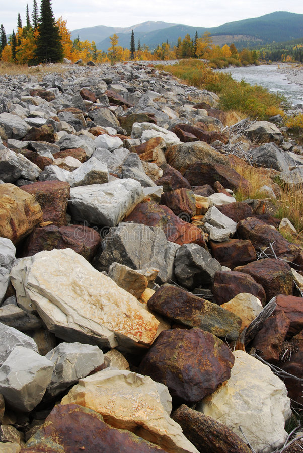Riverbank rocks royalty free stock photos