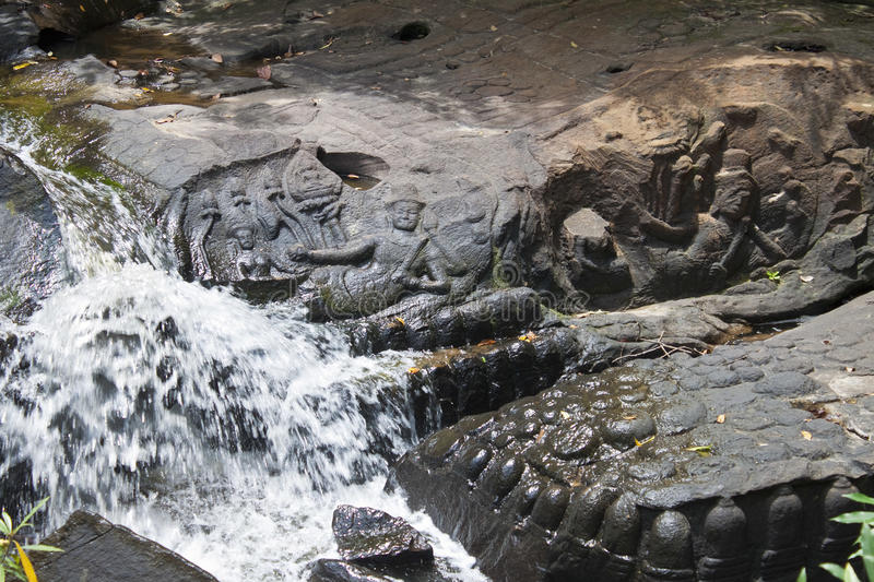 Riverbed carvings. At Kbal Spean in Angkor temple area, Cambodia royalty free stock image