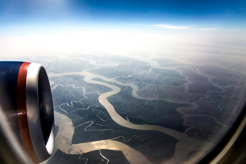 Rivers and sky in the airplane window 4 stock image