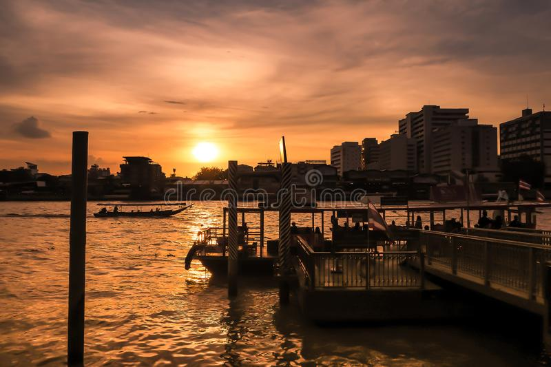 RiverScape of Bangkok City and Chao Phraya River with Beautiful Sunset from Maharaj pier in Bangkok City Thailand silhouette stock photography