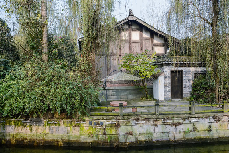 Riverside aged Chinese mansion at sunny winter noon. Huanglongxi town,Chengdu,China royalty free stock photo
