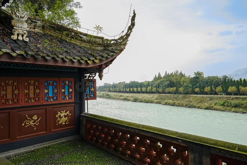 Riverside ancient Chinese building in sunny winter afternoon royalty free stock photos