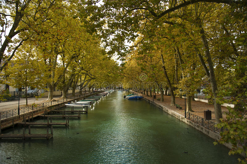 Riverside in Annecy canal stock images