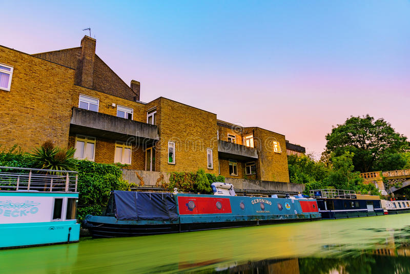 Riverside apartments with house boats royalty free stock photo