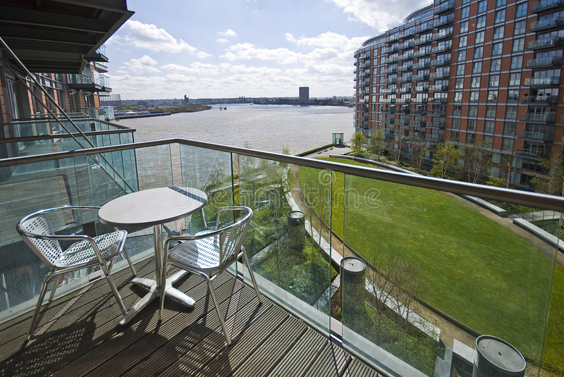 Riverside balcony with garden furniture royalty free stock photography