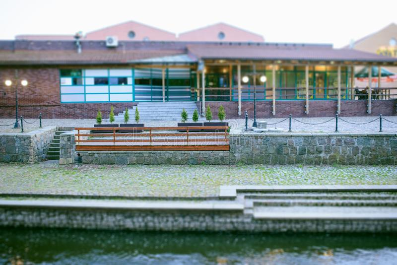 Riverside bar in town. A riverside bar building in town at dusk, city, modern, restaurant, travel, view, editorial, light, luxury, night, tourism, valley royalty free stock photos