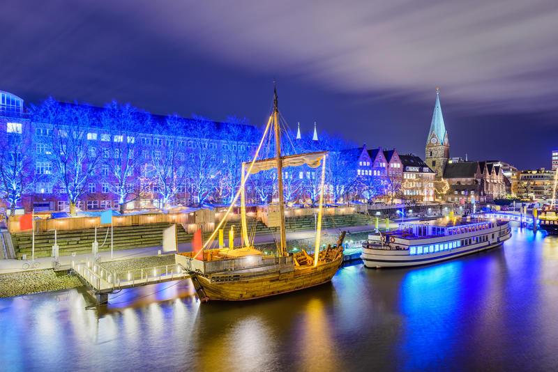 Riverside of Bremen, Germany during Christmas. Christmas market illumination at the riverside in Bremen, Germany royalty free stock photography