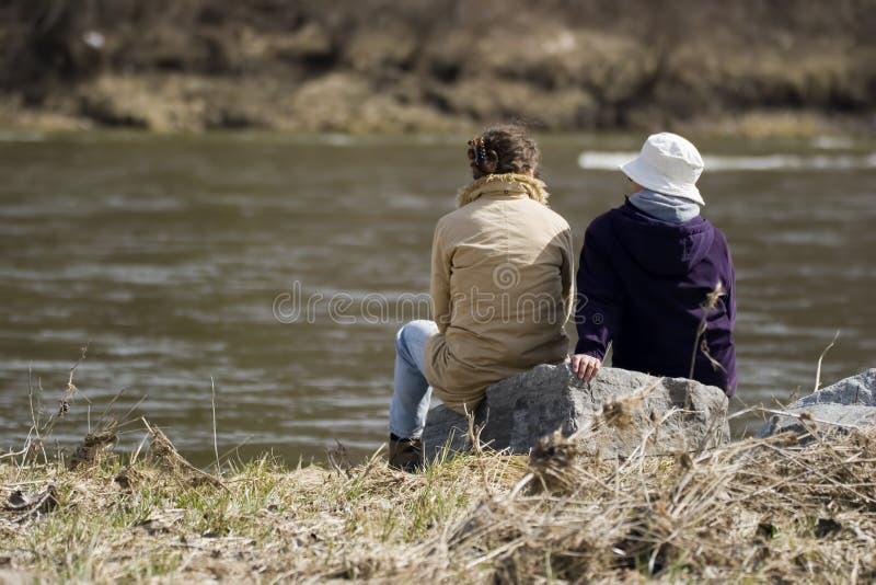 Download Riverside conversations stock photo. Image of rock, friendship - 754936
