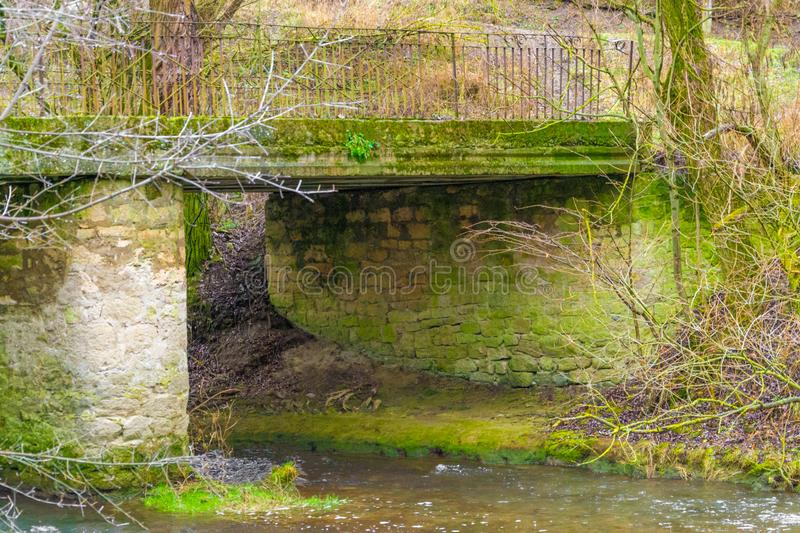 A riverside image of Hisley Bridge an old packhorse bridge over the river.  stock photo