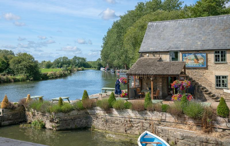 The Riverside Inn on the River Thames at Lechlade, Gloucestershire, United Kingdom. A popular location for leisure activities including walking, boating and royalty free stock photos