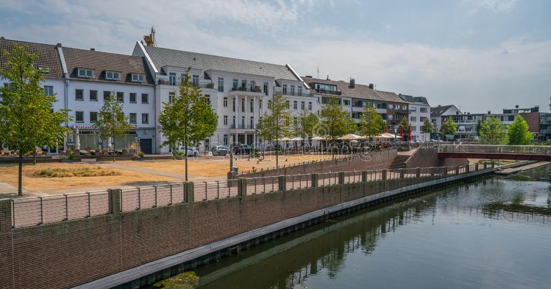 Riverside in Kleve, Germany. Kleve, Germany 21th July 2018 - people walking at the water side of the canal in Kleve stock images
